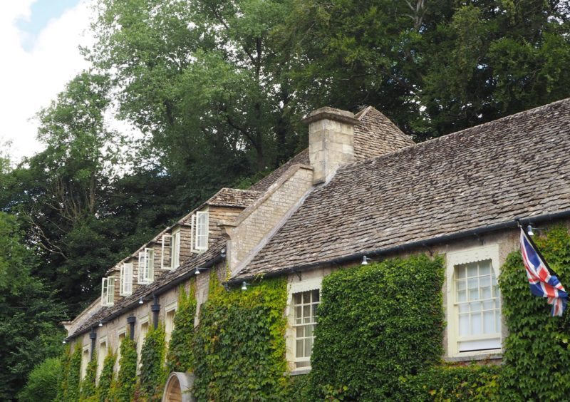 England Travel Inspiration - A day trip to one of the most beautiful Cotswolds villages, Bibury in Gloucestershire which is home to the gorgeous Arlington Row. Click through to read my travel tips for Bibury, Gloucestershire including where to find gluten free food in the village, when to visit and where to stay!