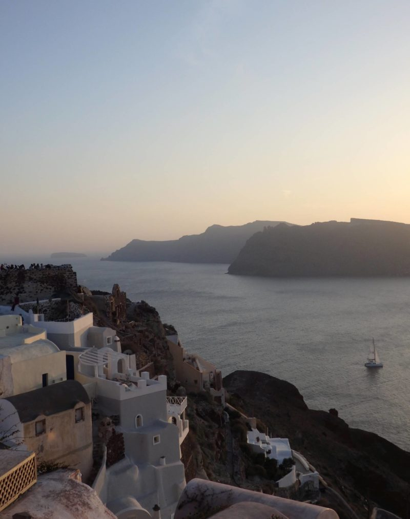 Greece Travel Inspiration - the Greek Islands are a bucket list destination for a good reason, let me show you how we spent 2 days in Santorini relaxing! Staying in Oia means you don't have to travel far to explore this beautiful spot and you can watch the sunset from your own private hot tub. Pop on over to the blog to read more of my tips for Santorini.