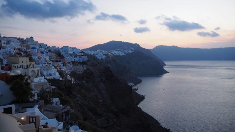 Greece Travel Inspiration - Catching the Sunrise in Oia, Santorini. Watching sunset on this beautiful Greek Island is a bucket list item however why not catch the sunrise which is less crowded and just as beautiful. Pop on over to the blog to see more sunrise photos in Oia.