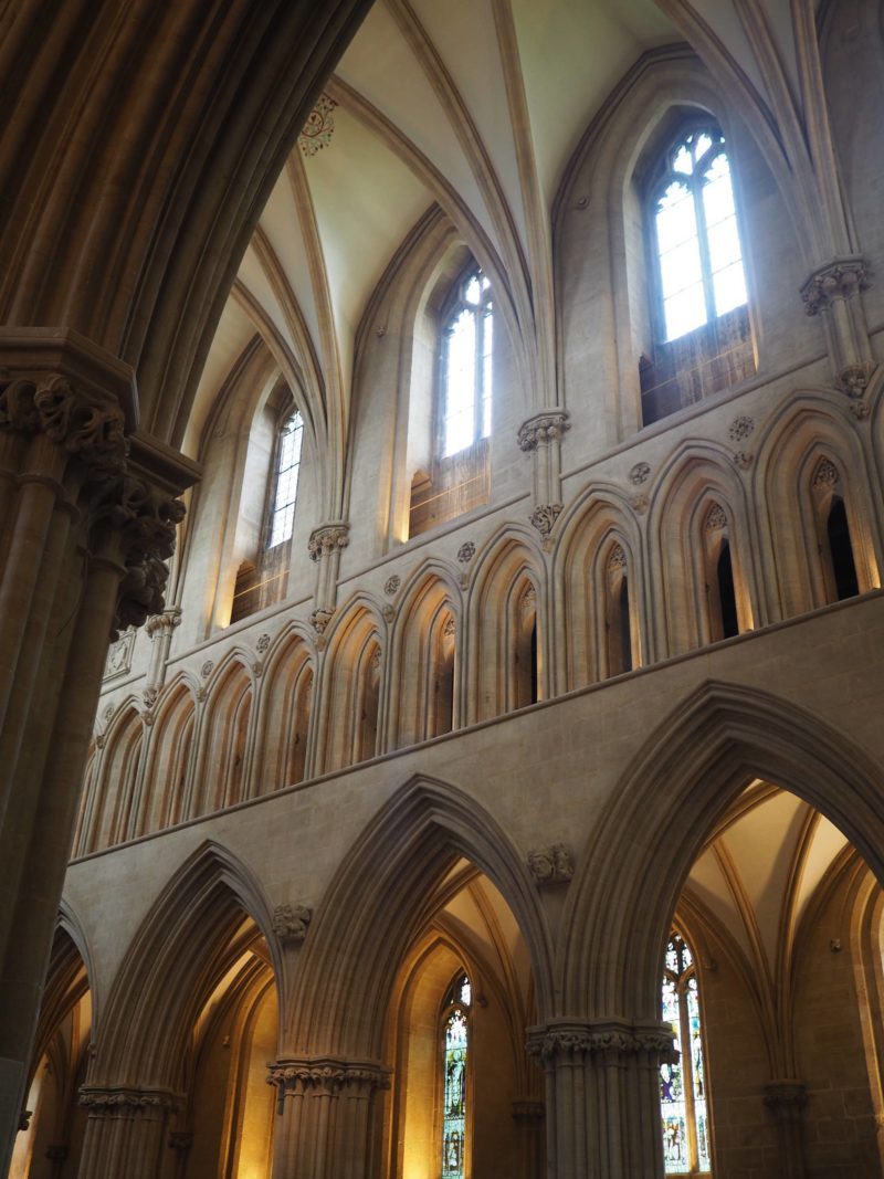 England Travel Inspiration - Exploring Wells, Somerset. I managed to tick off England's smallest city from my UK bucket list. Home to a beautiful cathedral and a Palace; this tiny city is a perfect day trip from London. Pop over to the blog to see my travel tips and more photos of Wells.