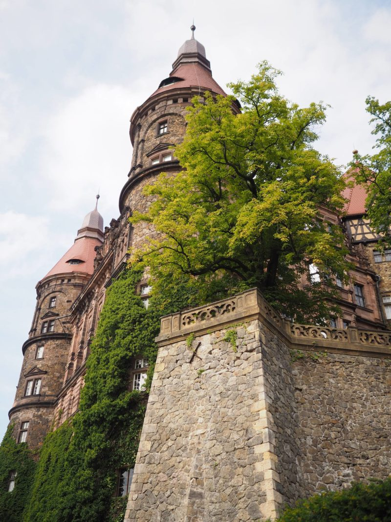 Poland Travel Inspiration - Ksiaz Castle, Poland: Hidden Treasure, A Missing Princess & A Scandalous Love Affair. Ksiaz Castle is one of Europe's most famous castles due to the tunnels running underneath the castle and the missing Gold Train. Definitely worth a visit while on a road trip through Poland or a day trip from Wroclaw. Click to see more photos and my travel tips