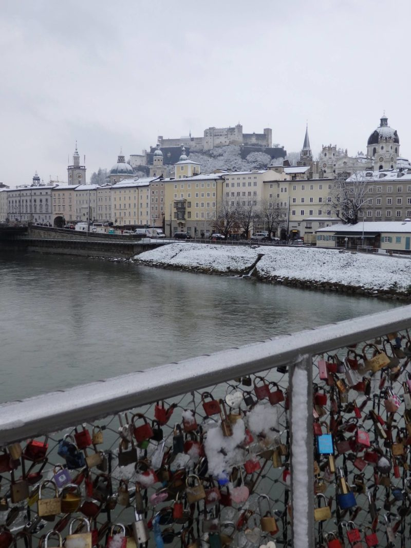 Austria Travel Inspiration - 48 Hours in Salzburg, Austria in Winter. This European city is a beautiful destination whichever season you decide to visit however with the Christmas Markets to explore in December and snow, it's like you are inside your own beautiful snow globe. Pop on over to the blog to read my travel guide to Salzburg and tips including gluten free food advice. #salzburg #austria #beautifuldestinations #bucketlistideas #80pairsofshoes